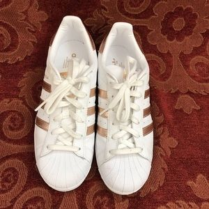Adidas leather sneakers with signature 3 stripes